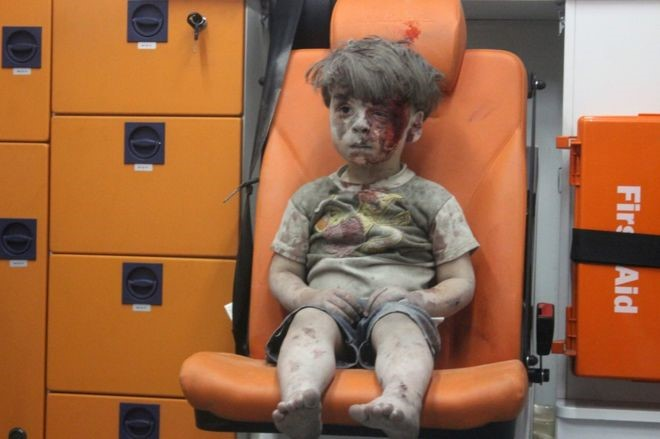 Snapshot from the video of Omran Daqnees in the back of an ambulance following his rescue