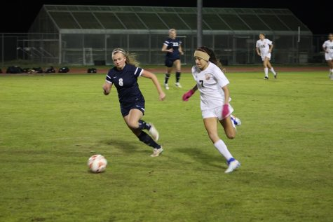 Brianna Vasquez dribbles away from a Cy Ranch defender.
