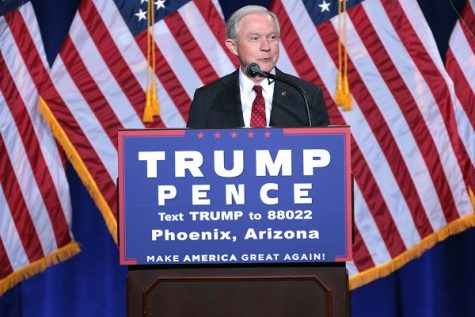 Jeff Sessions stands before an audience delivering a speech regarding Donald Trump's immigration policy.