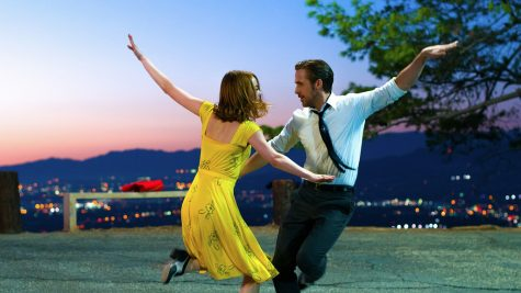 A shot of Ryan Gosling and Emma Stone dancing together.