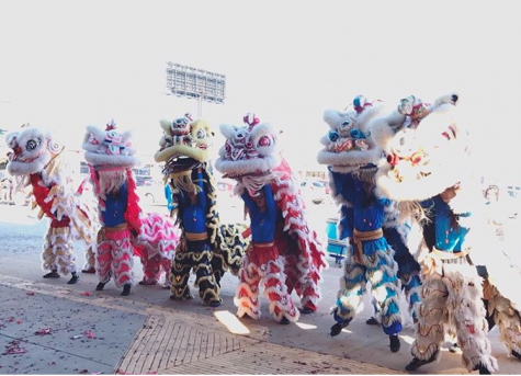 Anthu Le and her team dancing the lion dance.
