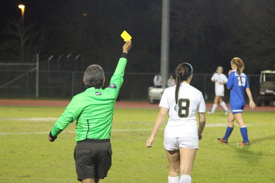 Lexi Fowler being sent off the field with a yellow card.