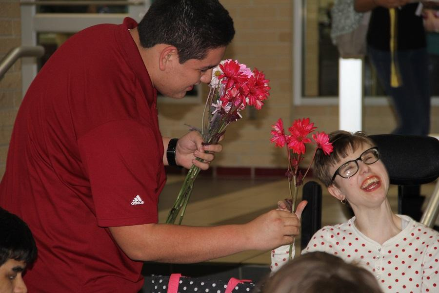 Passing out flowers and spreading smiles.
