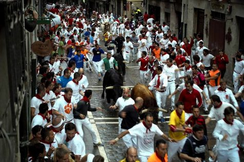 Participants run through the streets of Spain during the Running of the Bulls festival.