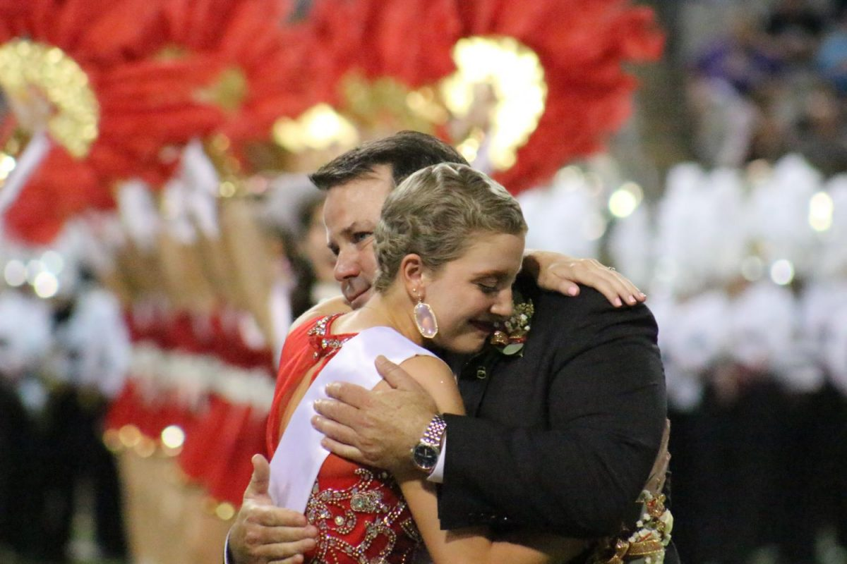 Senior+Maren+Mullally+hugs+her+father+after+being+announced+as+the+Homecoming+Queen.