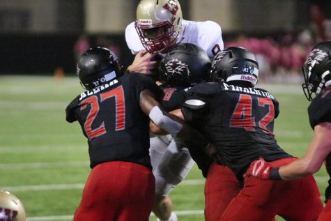 Quarterback Jackson Jones is tackled by multiple Langham Creek defenders as he attempts to make a two-point conversion during the fourth quarter.