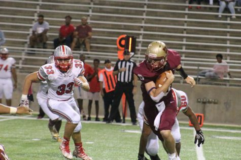 Quarterback Jackson Jones dodges a Cy Lakes defender as he runs with the ball during the second quarter.