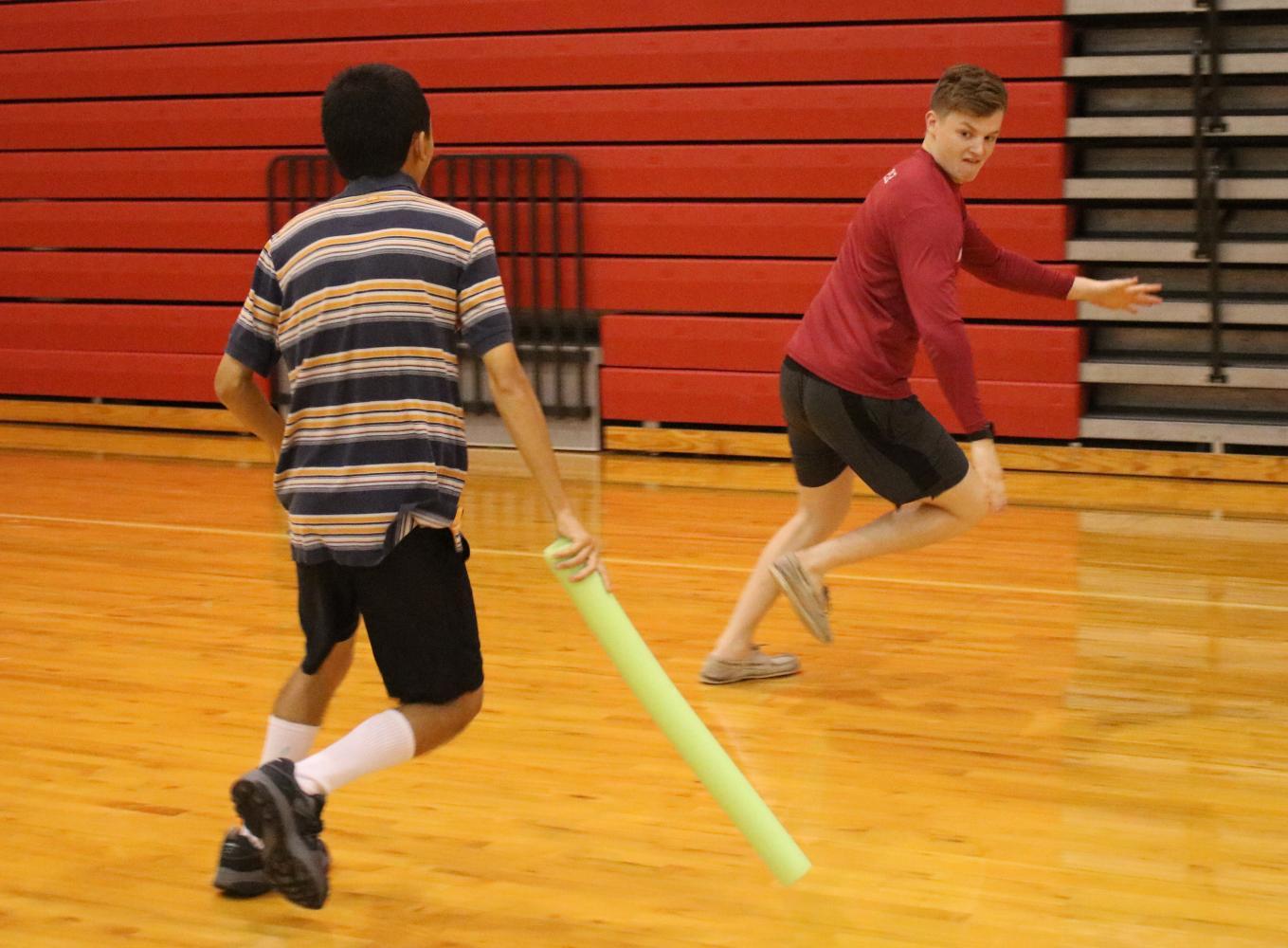 Junior+Jeremiah+Long+chases+senior+Peyton+Dunman.