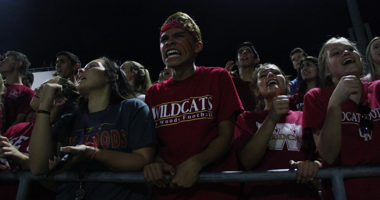 Senior Andrew Aguilar cheers at the Ridge game.