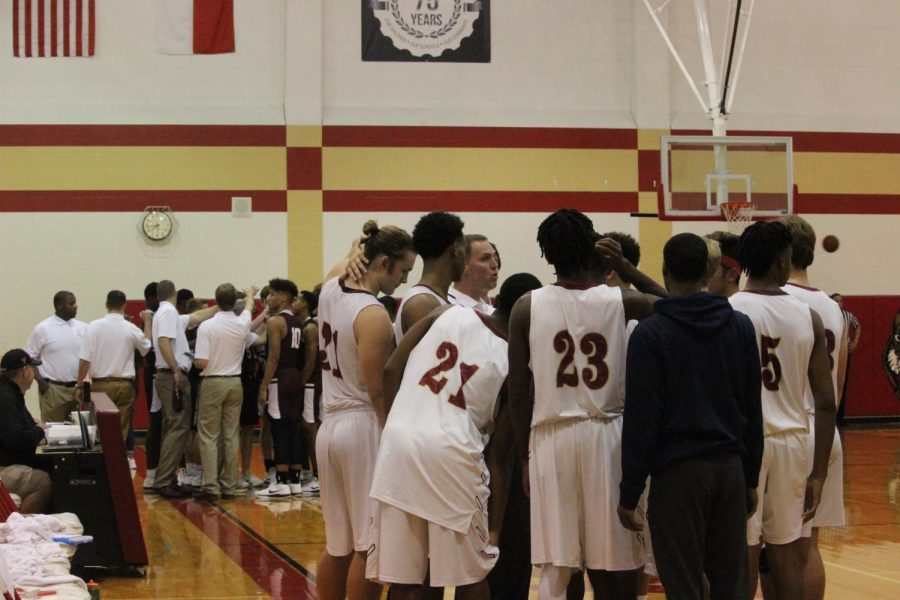 Wildcats huddle before the second quarter.