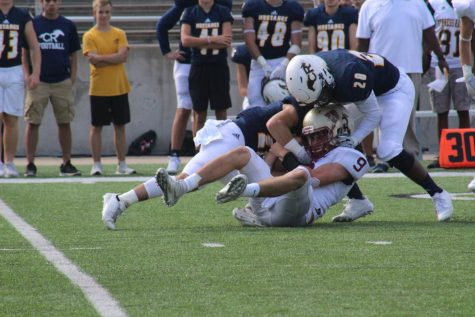 Quarterback Jackson Jones is sacked by two Cy Ranch defenders during the second quarter.