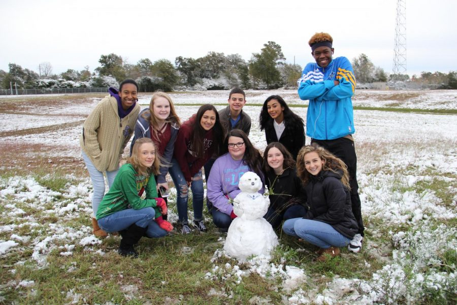 Journalism1 class poses with their snowman.