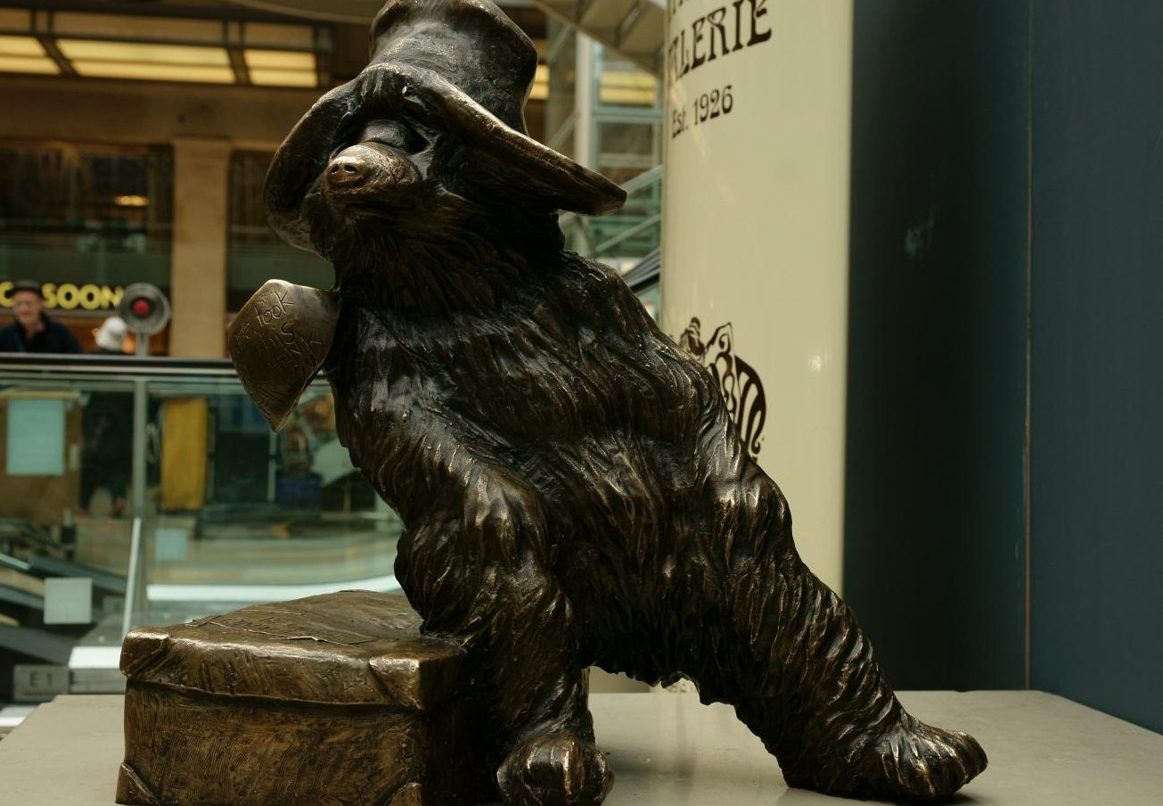 A statue of Paddington Bear from the beloved Paddington series at Paddington station in London.