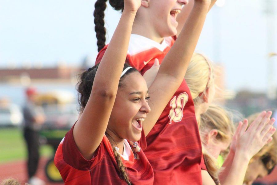 Sophomore Kiran Singh celebrates with her teammates after a Cy Woods goal during the game against the Cy Springs Panthers.
