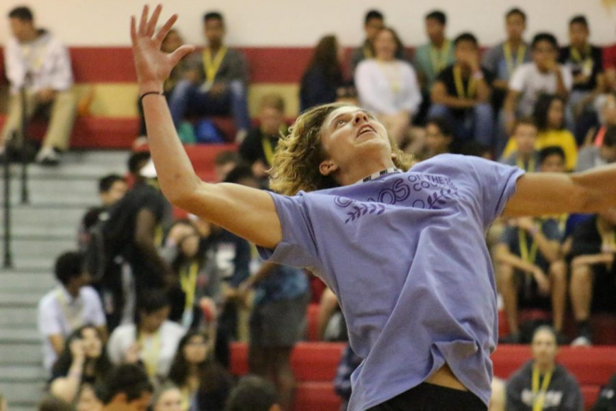 Senior Jared Swonke jumps up to hit a volleyball during warm-ups before Chaos on the Court.