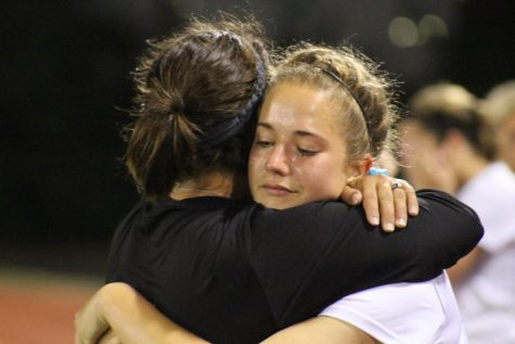 Senior Alyssa Correa hugs Assistant Coach Kellie Brewer after losing to Katy Tompkins 2-0 in overtime.
