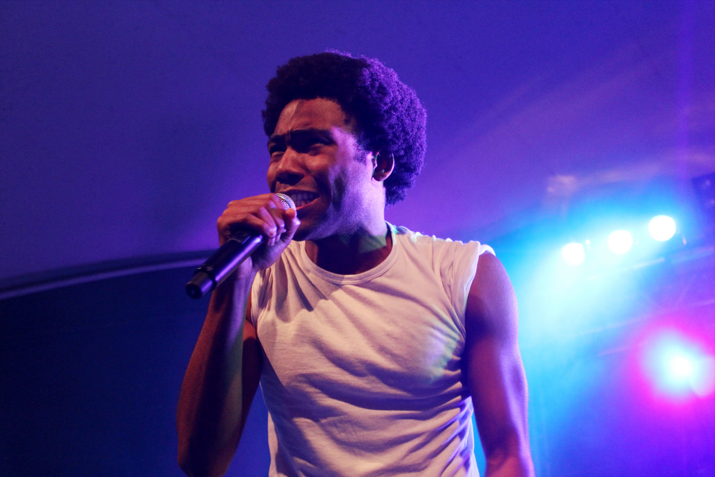 Donald Glover (Childish Gambino) performing on stage.