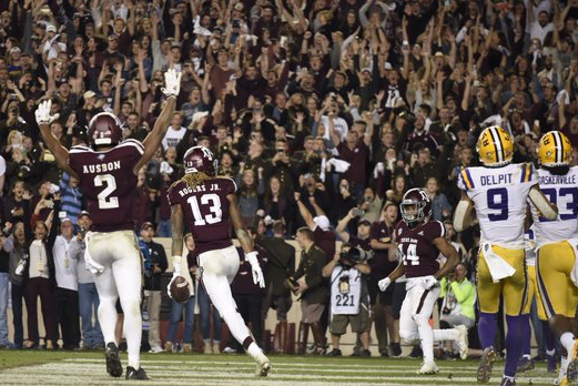 Jhamon Ausbon and Kendrick Rogers celebrate when the Aggies pulled off the victory.