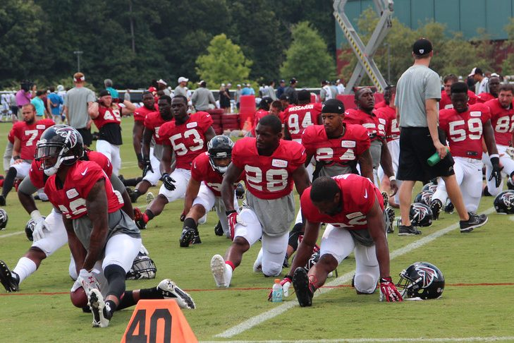Atlanta Falcon players stretch before practice.