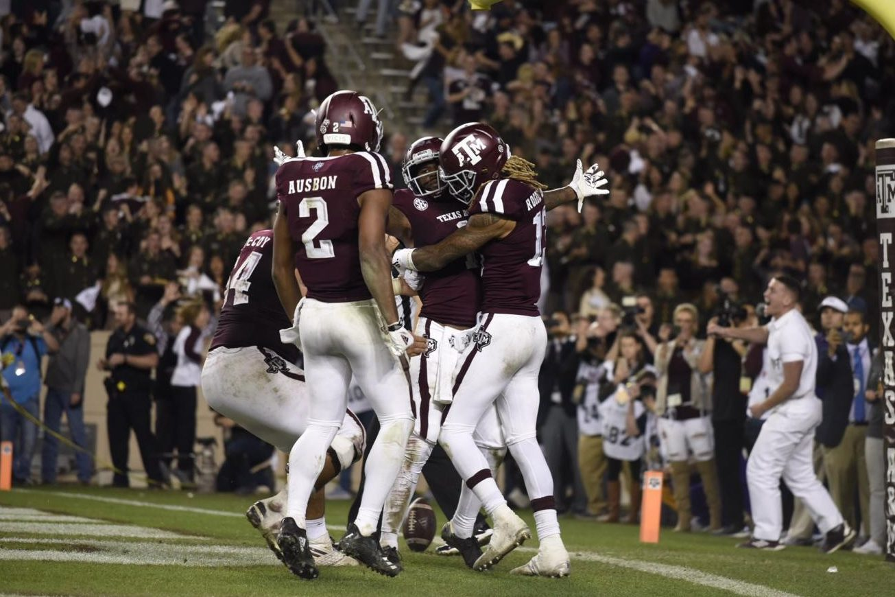 Aggie teammates celebrate after their LSU victory