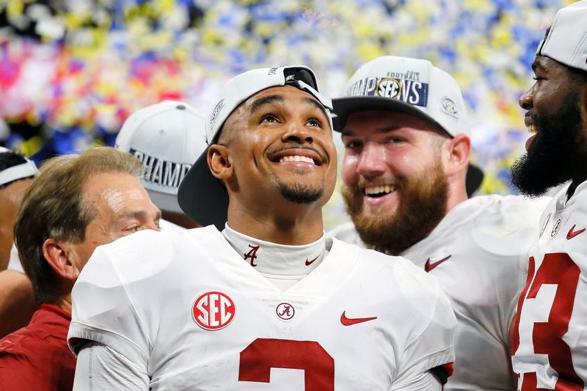Jalen Hurts  celebrates after defeating the Georgia Bulldogs