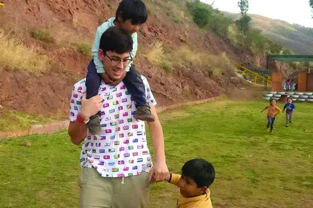 Mori spending time with kids  in Peru.