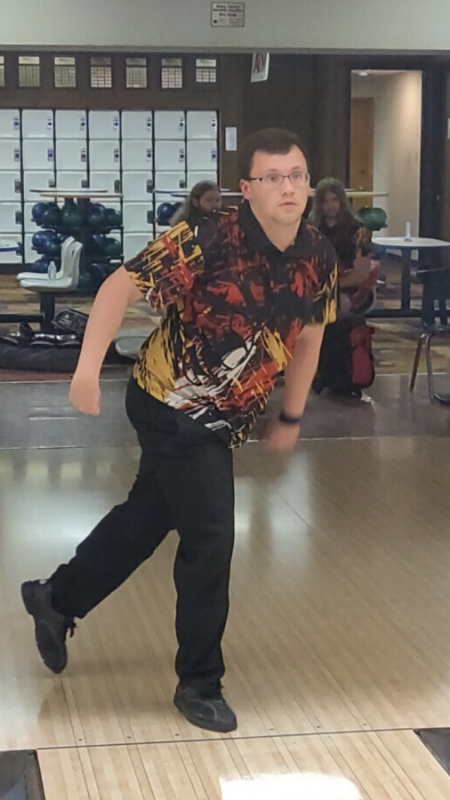 Senior Dakota Dudley rolling the bowling ball