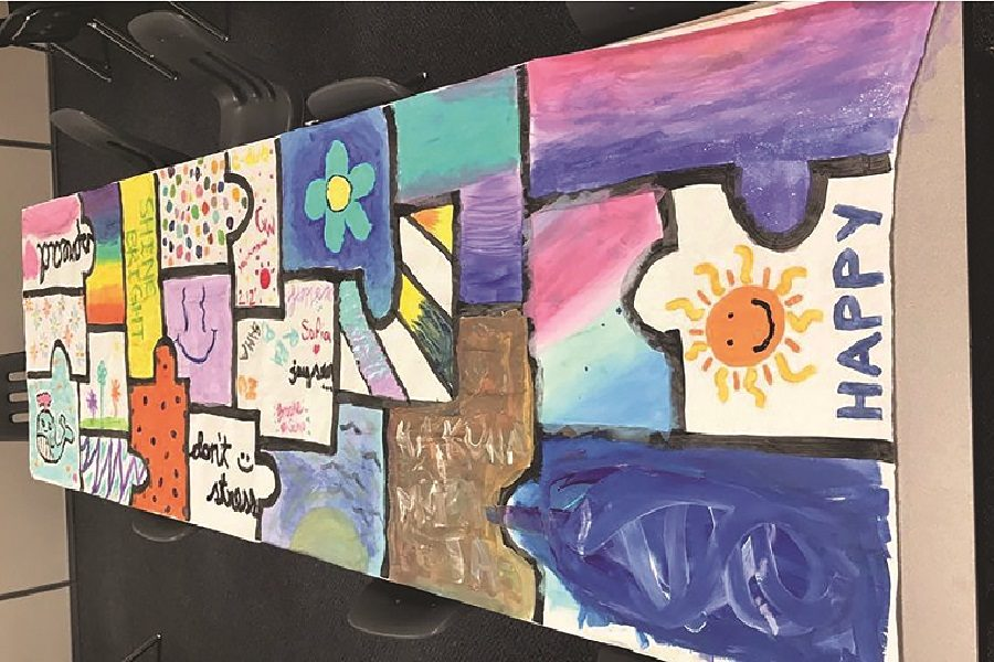 The puzzle piece poster made by students at Thursday's activity.
