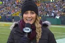 Erin Andrews, a well known female sports broadcaster, delivers game stats at a Packers game