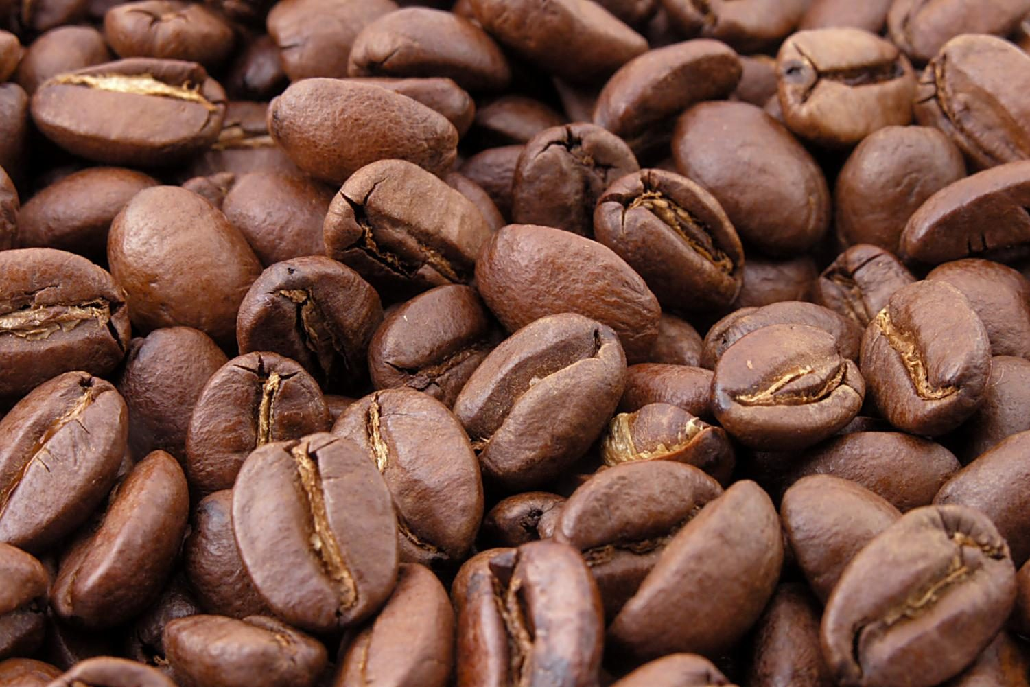 Scattered coffee beans on a table.
