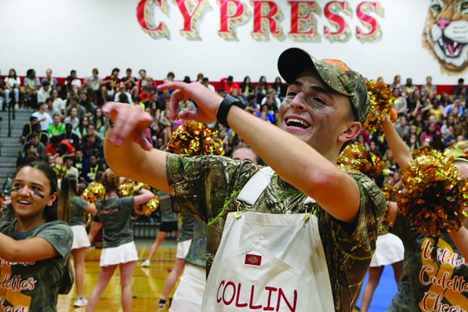 Senior Collin Bass dances at the Camo parade at Cy- Woods on September 6.