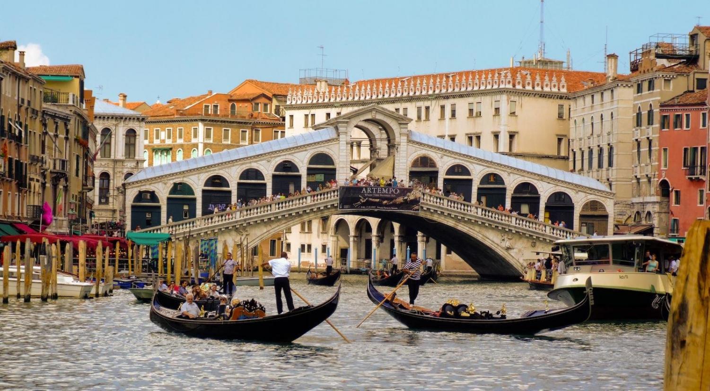 Gondolas sailing in Venice, Italy
