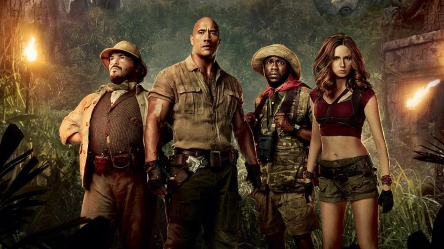 The characters Professor Oberon (Black), Dr. Bravestone (Johnson), Franklin Finbar (Hart) and Ruby Roundhouse (Gillan) ready to make their way through Jumanji.