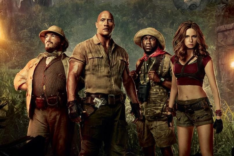 The characters Professor Oberon (Black), Dr. Bravestone (Johnson), Franklin Finbar (Hart) and Ruby Roundhouse (Gillan) ready to make their way through Jumanji.