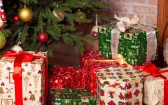 Christmas presents sitting under a Christmas tree.
