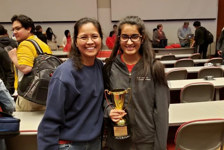 Iyer posing with her trophy