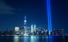 A blue light shines where the Twin Towers once stood.