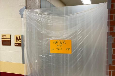 The boys bathroom with the water shut off to prevent students from going in.